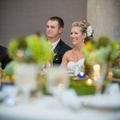 Bride & Groom at the Head Table; Photo Credit: The Third Image Photography